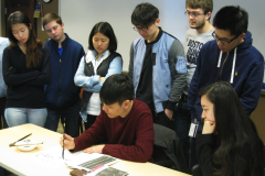 "Professor and calligrapher Tang Kaizhi leading a Chinese calligraphy workshop for Emory undergraduate students taking the course ""Chinese Writing Systems in Asia"" taught by Dr. Yu Li"